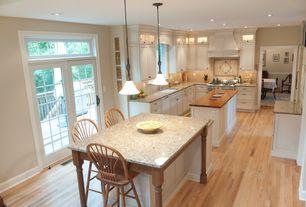 Traditional Kitchen with Breakfast bar, Wood counters, Solid medium oak windsor back bar stool, French doors, Custom hood