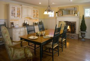 Country Dining Room with Pendant light, Crown molding, Built-in bookshelf, Hardwood floors, Chair rail