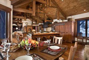 Rustic Dining Room with Built-in bookshelf, Exposed beam, High ceiling, Hardwood floors