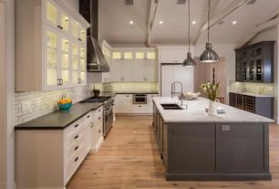 Traditional Kitchen with High ceiling, Subway Tile, Complex marble counters, Kitchen island, Hardwood floors, Glass panel