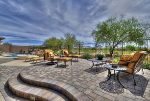 Contemporary Patio with Fence, exterior stone floors