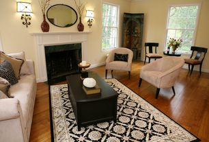 Traditional Living Room with Fireplace, Built-in bookshelf, brick fireplace, double-hung window, Wall sconce, Standard height