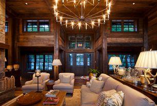 Country Great Room with Hardwood floors, Chandelier, Glass panel door, Columns, High ceiling
