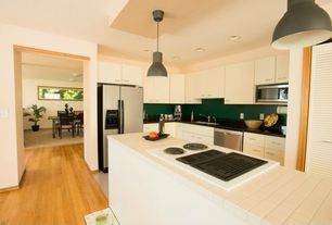 Contemporary Kitchen with European Cabinets, Soapstone counters, Flush, Oak - Seashell 2 1/4 in. Solid Hardwood Strip