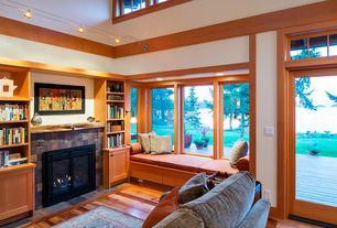Craftsman Living Room with Hardwood floors, Built-in bookshelf, flush light, French doors, Window seat, Transom window