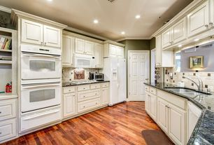 Traditional Kitchen with electric cooktop, dishwasher, six panel door, Raised panel, U-shaped, Hardwood floors, flush light