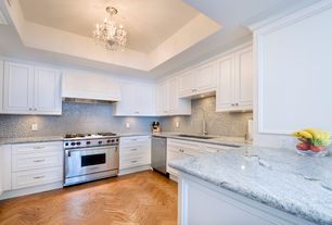 Traditional Kitchen with Flat panel cabinets, herringbone tile floors, Flush, Complex granite counters, Chandelier, U-shaped