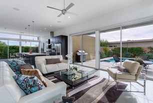 Modern Great Room with Ceiling fan, Standard height, sliding glass door, can lights, Concrete floors, Transom window