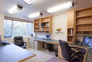 Craftsman Home Office with can lights, Carpet, Built-in bookshelf, Standard height, flush light, Casement