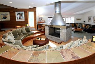Eclectic Great Room with stone fireplace, Standard height, Fireplace, can lights, Laminate floors, Sunken living room
