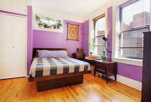 Eclectic Guest Bedroom with Casement, Art desk, Standard height, double-hung window, Hardwood floors, bedroom reading light