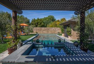 Contemporary Swimming Pool with exterior stone floors, Trellis, Fence, Pool with hot tub