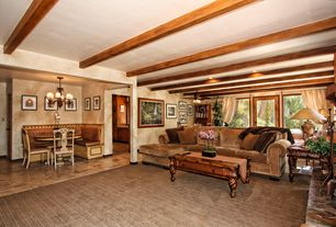 Traditional Great Room with Ceiling fan, interior wallpaper, French doors, Columns, Chandelier, Exposed beam