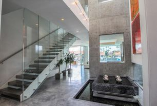 Contemporary Staircase with Concrete floors, Metal staircase, High ceiling