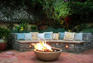Eclectic Patio with Backyard Fun Gas Fire Pit Bowl Round Kit, Surya Stunning Solid Pillow Cover, Fence, Fire pit, Raised beds