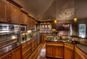 Traditional Kitchen with U-shaped, Simple granite counters, Kitchen island, built-in microwave, Limestone Tile, gas range
