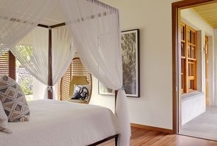 Tropical Guest Bedroom with Hardwood floors