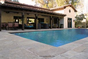 Traditional Swimming Pool with Oakland living web 7 piece dining set, Frameless, Fence, Lap pool, French doors, Exposed beam