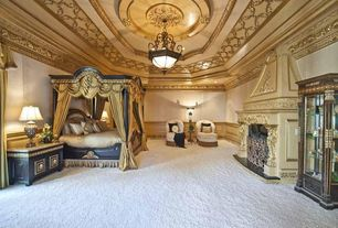 Traditional Master Bedroom with Fireplace, Chandelier, Standard height, Carpet, Crown molding, insert fireplace