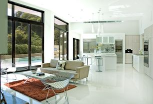 Modern Great Room with Pendant light, Transom window, simple marble floors, Bertoia diamond lounge chair with seat pad