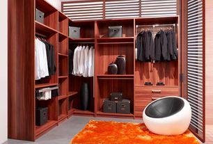 Contemporary Closet with Built-in bookshelf, Concrete floors