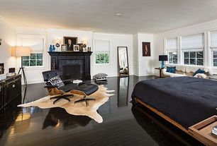 Contemporary Master Bedroom with Hardwood floors, Adjustable metal floor lamp - bronze, stone fireplace, Crown molding