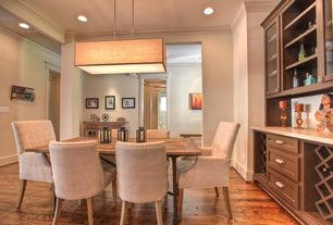 Contemporary Dining Room with Built-in bookshelf, Hardwood floors, flush light, Columns, Crown molding