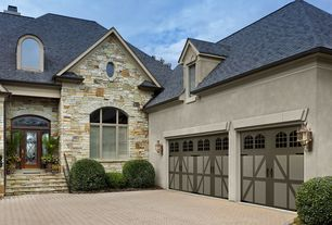 Country Garage with Exterior stone wall, Paint 1, Paint, High ceiling, Casement, Arched window, Barn door, Paint 3