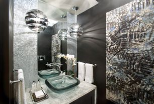 Eclectic Powder Room with Waterfall countertop, Pendant light, Vessel sink, Tom dixon mirror ball pendant, Ceramic Tile