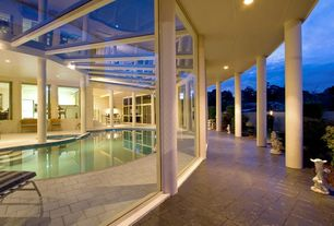 Modern Swimming Pool with exterior stone floors, picture window, Skylight, Indoor pool, sliding glass door