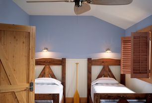 Country Kids Bedroom with Ceiling fan, Barn door, Hardwood floors, Wainscotting