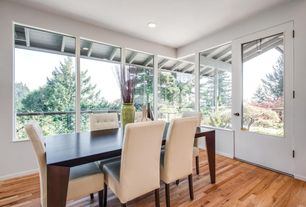Contemporary Dining Room with French doors, Hardwood floors