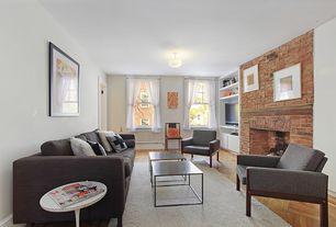 Contemporary Living Room with Built-in bookshelf, Hardwood floors, flush light