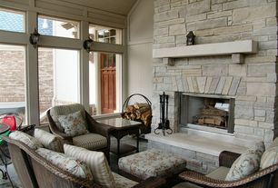 Country Living Room with stone fireplace, Imperial 2 Light Wall Sconce, Wicker Sands Square End Table, soapstone tile floors
