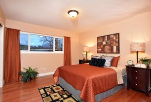 Contemporary Master Bedroom with flush light, Hardwood floors, Wood nightstand, Area rug, Table lamp, Accent curtain