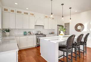 Traditional Kitchen with Kitchen island, Breakfast bar, Pendant light, Flat panel cabinets, Flush, Glass panel, Paint