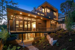 Contemporary Exterior of Home with Living roof, Charred cedar siding