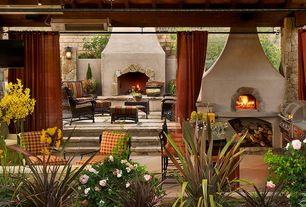 Mediterranean Porch with Raised beds, Outdoor seating, exterior stone floors, Outdoor kitchen, Outdoor curtains, Pathway