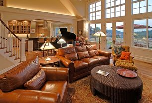 Traditional Great Room with High ceiling, French doors, Hardwood floors, Built-in bookshelf