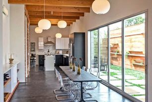 Contemporary Dining Room with sliding glass door, Pendant light, Exposed beam, Wall sconce, High ceiling, Ikea tobias chair