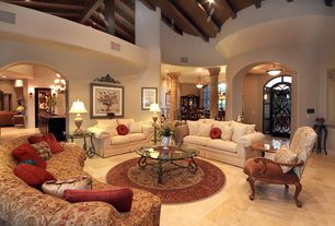 Traditional Living Room with Cathedral ceiling, Columns, can lights, Exposed beam, Loft, stone tile floors