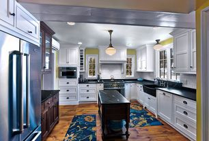 Country Kitchen with Subway Tile, Pendant light, Flat panel cabinets, can lights, Farmhouse sink, Inset cabinets, U-shaped