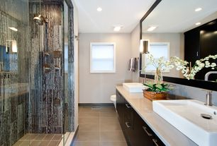 Contemporary Master Bathroom with Rain shower, frameless showerdoor, Stonepeak Ceramics Sky Tile - Moonsky, European Cabinets