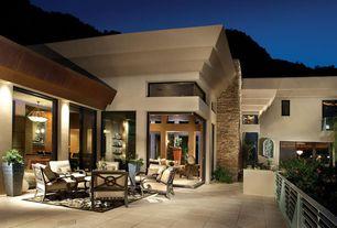 Contemporary Patio with Deck Railing, exterior concrete tile floors, sliding glass door, picture window, Pathway