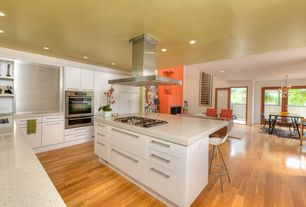 Contemporary Kitchen with Kitchen island, L-shaped, European Cabinets, Simple granite counters, Breakfast bar, Flush