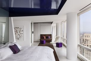 Contemporary Master Bedroom with Concrete floors, Columns