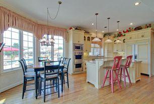 Cottage room with Hardwood floors, Crown molding, Pendant light, Chandelier, Built-in bookshelf