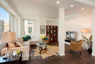 Contemporary Living Room with Hardwood floors, Columns, Built-in bookshelf