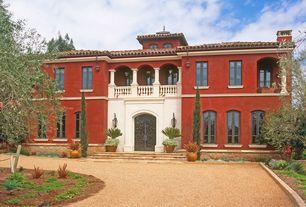 Mediterranean Front Door with French doors, exterior stone floors, Deck Railing, Casement