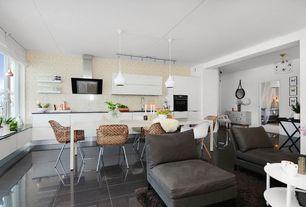 Modern Great Room with Pendant light, Exposed beam, Built-in bookshelf, flush light, interior wallpaper, simple marble floors